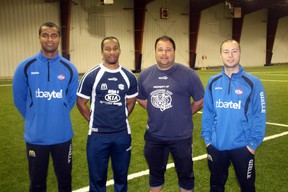 Four members of the Thunder Bay Chill soccer team at the indoor field at the new Sportsplex after hosting two days of skills training camps for local players.
