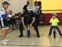 BRUCE BELL/THE INTELLIGENCER Prince Edward OPP Const. Anthony Mann challenges Brandon, a Massassaga-Rednersville Public School student, to a race during the Pedal for Hope Quinte kickoff Monday morning.