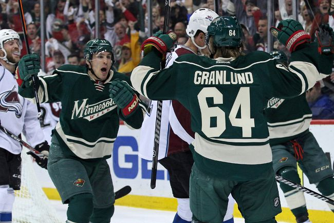 Minnesota Wild forward Mikael Granlund (64) celebrates his goal with forward Zach Parise (11) during the first period against the Colorado Avalanche in Game 6 of the first round of the 2014 Stanley Cup Playoffs at Xcel Energy Center. (Brace Hemmelgarn-USA TODAY Sports)