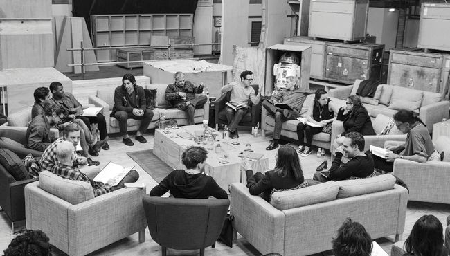 """Writer/Director/Producer J.J. Abrams (top center in glasses) conducts a cast reading for """"Star Wars: Episode VII"""" at Pinewood Studios in Buckinghamshire in this publicity photo taken and released to Reuters April 29, 2014. Clockwise from Abrams are Harrison Ford, Daisy Ridley, Carrie Fisher, Peter Mayhew, Producer Bryan Burk, Lucasfilm President and Producer Kathleen Kennedy, Domhnall Gleeson, Anthony Daniels, Mark Hamill, Andy Serkis, Oscar Isaac, John Boyega, Adam Driver and writer Lawrence Kasdan.  REUTERS/David James/Copyright (c) Lucasfilm Ltd. & TM. All Rights Reserved/The Walt Disney Company/Handout"""