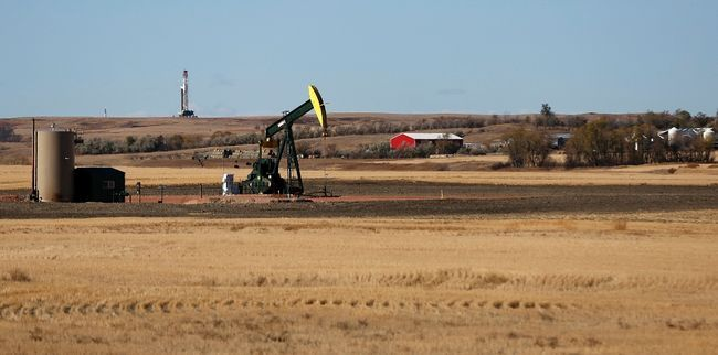 "The provincial government has made changes to the Agricultural Land Commission, including allowing ""value-added farming activities"" on farmland that some critics fear could turn into industrial changes like this oil rig and an oil pump jack on a farm in rural North Dakota. (REUTERS)"
