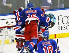 The New York Rangers celebrate defeating the Philadelphia Flyers in Game 7 of their Eastern Conference quarterfinal series at Madison Square Garden in New York, April 30, 2014. (ADAM HUNGER/USA Today)