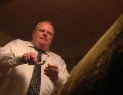 Stills from a video that was offered for sale to the website Gawker.com. The seller told the website that the pipe in Mayor Rob Ford's hand contained crack cocaine. (Photo courtesy Gawker.com)