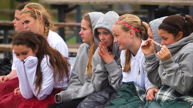 Sitting on the bench on a cold drizzly day isn't a lot of fun but sleeping bags kept the girls from Strathroy's Holy Cross Catholic High School warm during their game against St. Mary's from Woodstock at the City Wide fields in London, Ont. on Wednesday April 30, 2014. Mike Hensen/The London Free Press/QMI Agency