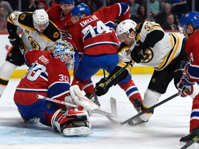 Montreal Canadiens goalie Peter Budaj (30) makes a save on Boston Bruins forward Patrice Bergeron (37) during the first period at the Bell Centre earlier this season. (Eric Bolte-USA TODAY Sports)