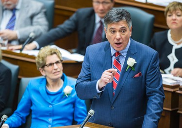 Ontario Premier Kathleen Wynne looks on as Finance Minister Charles Sousa as he announces the provincial budget at Queen's Park in Toronto, Ont.  on Thursday May 1, 2014. Ernest Doroszuk/Toronto Sun/QMI Agency