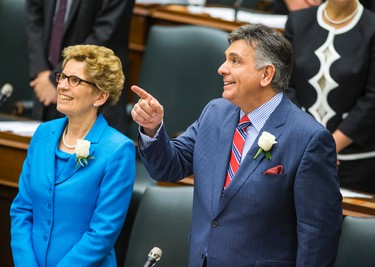 Ontario Premier Kathleen Wynne with   Finance Minister Charles Sousa as he announces the provincial budget at Queen's Park in Toronto, Ont.  on Thursday May 1, 2014. Ernest Doroszuk/Toronto Sun/QMI Agency
