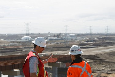 Flatiron engineers Rob Richardson (left) and Travis Pehlke chat while lookout out on the Northeast Anthony Henday Drive at the worksite in Edmonton, Alta., on Thursday, May 1, 2014. The project is set to be completed in 2016. By fall 2014, 1.4 million work hours will be done by crews to open a new interchange, new pavement and two new bridges. Ian Kucerak/Edmonton Sun/QMI Agency