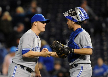 Toronto Blue Jays relief pitcher Aaron Loup (62) celebrates with catcher Josh Thole (22) after a win over the Kansas City Royals on May 1. (John Rieger-USA TODAY Sports)