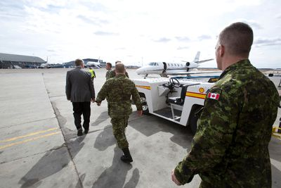 Dignitaries and military members head out to see off fifty soldiers from the 3rd Battalion, Princess Patricia's Canadian Light Infantry at the Shell Aerocentre in Edmonton, Alta., on Friday, May 2, 2014. The soldiers are deploying to Poland as part of Exercise Orzel Alert, in response to the ongoing crisis in the Ukraine. Ian Kucerak/Edmonton Sun/QMI Agency