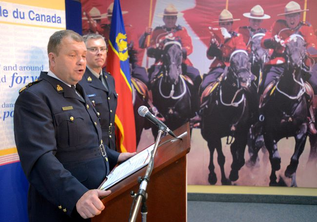 RCMP Superintendent Jamie Jagoe announces the arrest of nine people accused of illegally selling tobacco on the black market during a press conference at RCMP O Division headquarters in London, Ontario on May 2, 2014.
