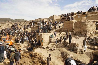 Afghan villagers gather at the site of a landslide at the Argo district in Badakhshan province, May 3, 2014. Afghan officials gave up hope on Saturday of finding any survivors from a landslide in the remote northeast, putting the death toll at more than 2,100, as the aid effort focused on the more than 4,000 people displaced. Officials expressed concern the unstable hillside above the site of the disaster may cave in again, threatening the thousands of homeless and hundreds of rescue workers who have arrived in Badakhshan province, bordering Tajikistan. REUTERS/Stringer