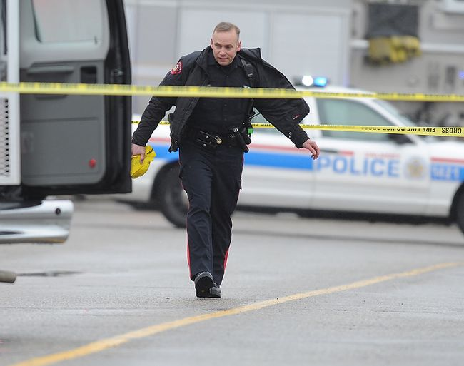 Calgary City Police investigate the crime scene at home where at least one person is dead and multiple others injured in a stabbing incident on Penbrook Drive in SE Calgary, Alta. on Sunday May 4, 2014. Stuart Dryden/Calgary Sun/QMI Agency