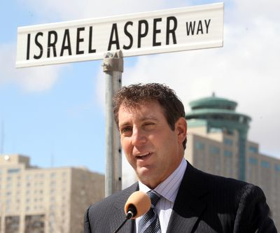 Leonard Asper speaks after a section of Waterfront Drive was renamed Israel Asper Way in Winnipeg, Man. Monday May 05, 2014. Brian Donogh/Winnipeg Sun/QMI Agency