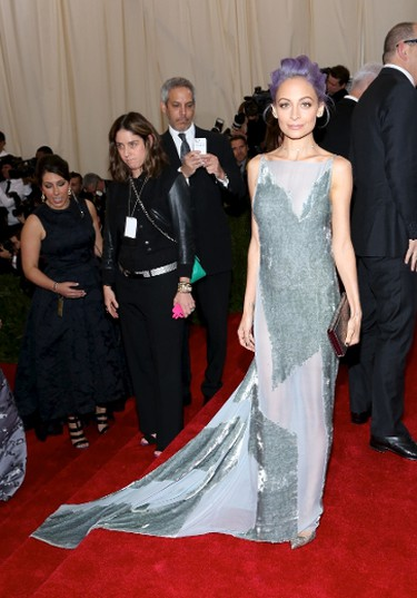 "Nicole Richie knows how to style a look for her tiny frame. She opted for an asymmetrical and backless velvet grey Donna Karan gown.  (Andres Otero/WENN.com)  PDRTJS_settings_7613712 = { ""id"" : ""7613712"", ""unique_id"" : ""default"", ""title"" : """", ""permalink"" : """" };"