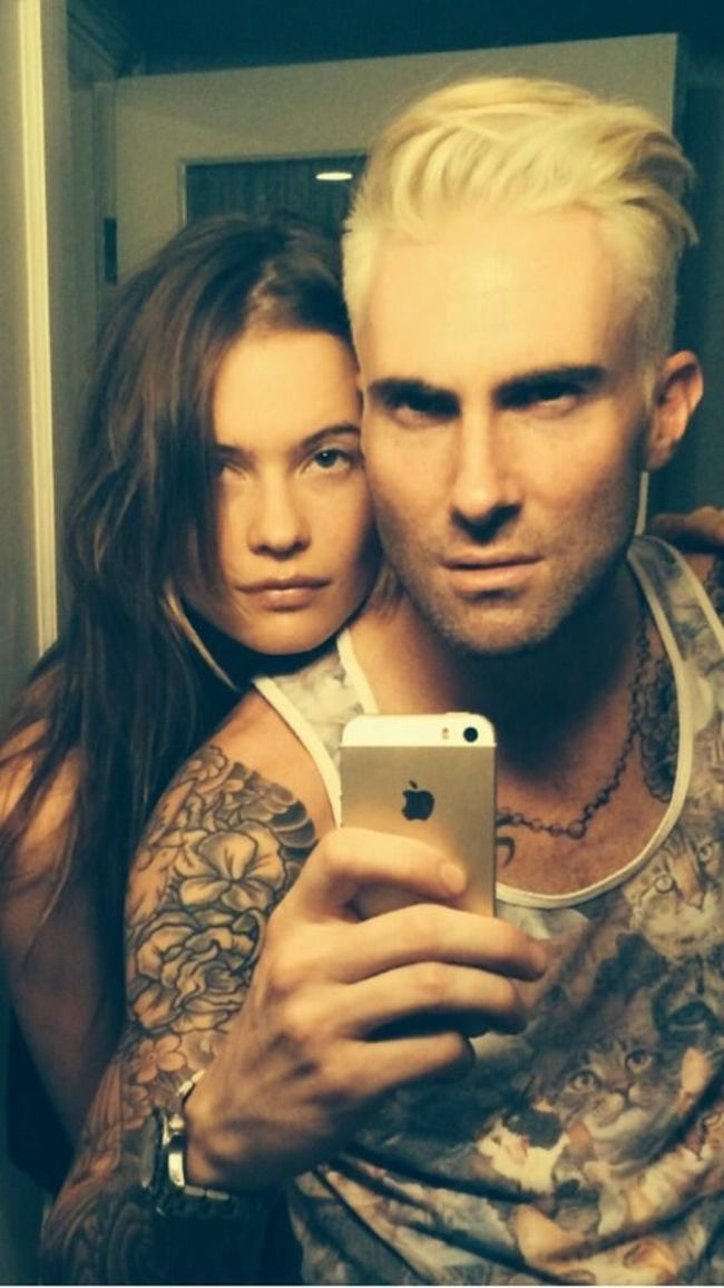 "Adam Levine tweeted a photo with fiancee Behati Prinsloo and his new hairdo with the caption: ""Apocalypse prep course complete."" (twitter.com/adamlevine)"