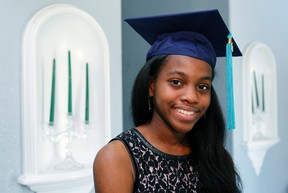 Grace Bush poses in her university graduation cap at her home in West Park, Florida, May 6, 2014. (REUTERS/Andrew Innerarity)