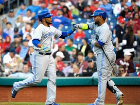 Toronto Blue Jays first baseman Edwin Encarnacion (left) celebrates with with designated hitter Juan Francisco after hitting a home run against the Philadelphia Phillies at Citizens Bank Park in Philadelphia, May 6, 2014. (ERIC HARTLINE/USA Today)