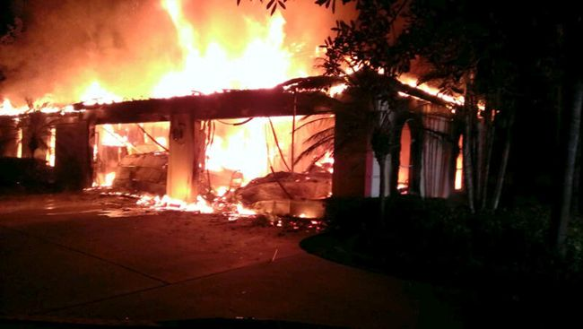 Flames engulf a house owned by former tennis pro James Blake in this handout photograph provided by the Hillsborough Sheriff's Office in Tampa, Florida May 7, 2014. (REUTERS/Hillsborough County Sheriff's Office/Handout via Reuters)