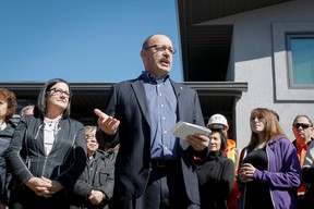 Ric McIver speaks in front of supporters outside his home in Calgary, Alta., on Wednesday, May 7, 2014. McIver announced his bid for the provincial PC leadership. Lyle Aspinall/Calgary Sun/QMI Agency