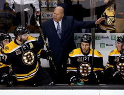 Boston Bruins head coach Claude Julien talks with center Patrice Bergeron (37) during the third period against the Montreal Canadiens in game one of the second round of the 2014 Stanley Cup Playoffs at TD Banknorth Garden on May 1, 2014 in Boston, MA, USA. (Greg M. Cooper/USA TODAY Sports)