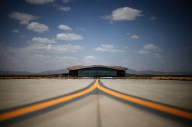 Spaceport America's Virgin Galactic Gateway to Space Building is seen near Truth or Consequences, New Mexico May 1, 2014. The world's first purpose-built commercial space base and soon-to-be site of the first space flights with Sir Richard Branson's Virgin Galactic is near the town of Truth or Consequences in New Mexico. The inaugural flight into suborbital space should happen later this year and the first astronauts, who have made reservations and paid $250,000 for the flight, should follow a month later. While it's not clear what the economic impact will be, many agree that Spaceport America should inject new energy into the town. Picture taken May 1, 2014.      REUTERS/Lucy Nicholson