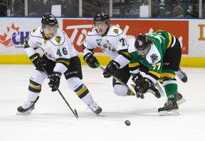 Team White forward Chris Tierney, middle, goes airborne as he and fellow Team White forward Matt Rupert, left, keep the puck away from Team Green forward Tristen Elie during an intrasquad game at Budweiser Gardens on Friday. (CRAIG GLOVER, The London Free Press)