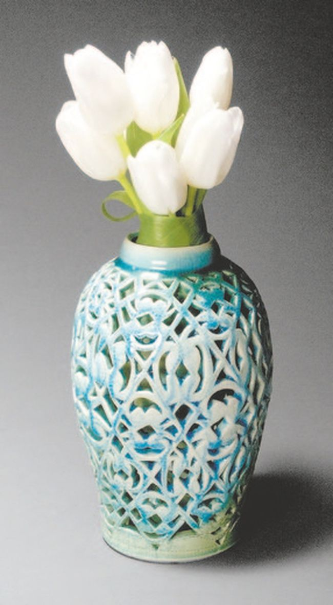 Sheridan College graduating ceramic art student Rhoni Clarke's cutout vase is part of a new exhibition by graduates of the renowned program opening at Jonathon Bancroft-Snell Gallery Wednesday.