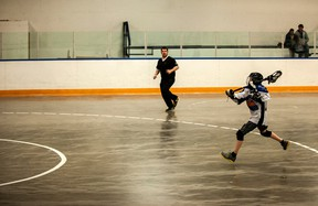A Vermilion lacrosse player takes a shot on goal while on a breakaway.