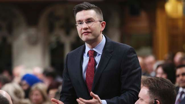 Minister of State for Democratic Reform Pierre Poilievre speaks during Question Period in the House of Commons on Parliament Hill in Ottawa March 27, 2014. REUTERS/Chris Wattie
