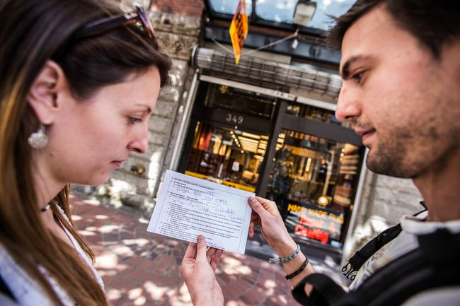 Almudena Ruano, left, and boyfriend Javier Perez examine a receipt they received from a woman they say scammed them out of $400, and whom they identify from photographs as Ruby Gifford. (CARMINE MARINELLI/ 24 HOURS)