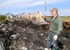Kingston Park Raceway groundskeeper Ricky Cameron looks over a barn on Monday after a fire in north-end Kingston on Sunday killed four horses. Eight horses were rescued. IAN MACALPINE /THE WHIG-STANDARD