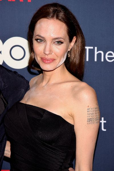Angelina Jolie made a red carpet appearance with fiance Brad Pitt for his HBO movie, The Normal Heart. Not everything was red carpet as usual, as Jolie appeared to have white powder on her cheek and forehead. Perhaps, her makeup artist forgot to blend. (Joseph Marzullo/WENN.com)