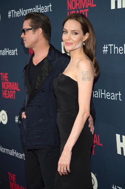 """Actors Brad Pitt and Angelina Jolie attend the premiere of """"The Normal Heart"""" in New York May 12, 2014. (REUTERS/Andrew Kelly)"""