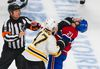 Torey Krug strikes Brian Gionta in the third period of Game 6 between the Montreal Canadiens and Boston Bruins at the Bell Centre on May 12, 2014. (QMI Agency)