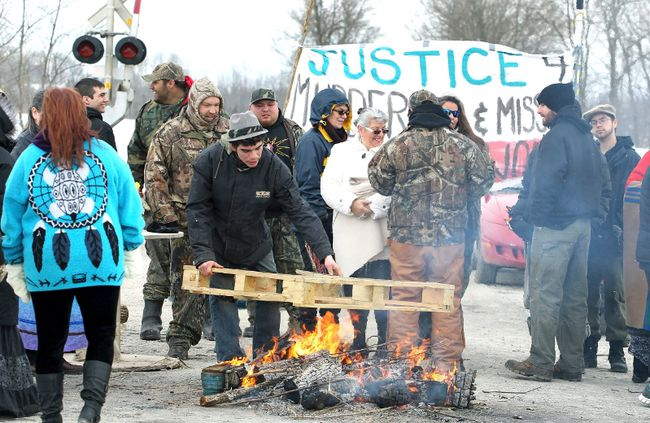 First Nation's bands form a blockade at the main VIA rail line between Toronto and Ottawa near Marysville, Ontario March 19, 2014. The blockade was part of a day of action to call attention to missing and murdered indigenous and aboriginal women.  (REUTERS/Fred Thornhill)