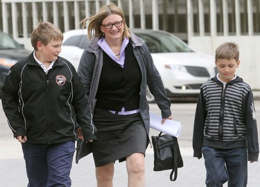 City councillor Paula Havixbeck arrives at City Hall with her sons Nick (l) and Adrian to file her nomination papers for mayor in Winnipeg, Man. Wednesday May 14, 2014. Brian Donogh/Winnipeg Sun/QMI Agency
