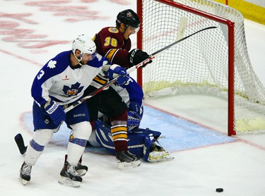 T.J. Brennan of the Toronto Marlies battles for the puck against Sebastian Wannstrom of the Chicago Wolves during game 3 of a best of 7 series during the second round of the AHL Playoffs at the Ricoh Coliseum in Toronto on Wednesday May 14, 2014. Dave Abel/Toronto Sun/QMI Agency