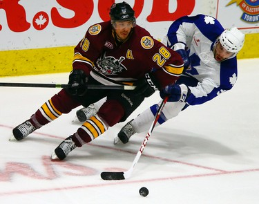 Greg McKegg of the Toronto Marlies strips the puck from Brent Regner of the Chicago Wolves during game 3 of a best of 7 series during the second round of the AHL Playoffs at the Ricoh Coliseum in Toronto on Wednesday May 14, 2014. Dave Abel/Toronto Sun/QMI Agency