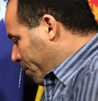 Algerian citizen Mohamed Harkat wipes away tears during a news conference on Parliament Hill in Ottawa May 15, 2014. The Canadian government was within its rights to order Harkat's deportation, the Supreme Court of Canada ruled on Wednesday, upholding a lower court's finding that Harkat was a liar and likely a sleeper agent for terrorist organizations. Harkat had come to Canada as a refugee claimant and been taken into custody in 2002 under a security certificate. He has since been allowed to go free pending the outcome of this case.  Tony Caldwell/Ottawa Sun/QMI Agency