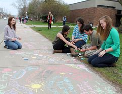Paris District High School students Selaria Timon, left, Gabi Traplin, Emily Kyle, Michael Pirillo and Lisa Madden draw positive images and messages on the sidewalk for the Let's Chalk event to mark Mental Health Awareness week. MICHAEL PEELING/THE PARIS STAR/QMI AGENCY