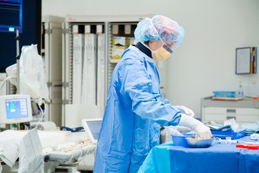 Julie Hawkhisstone, scrub nurse, prepares the OR for Gordon Reid who had a stent put in a clogged artery by Dr. Jaffer Syed, interventional cardiologist, during a procedure at the St. Catharines Hospital on Thursday, May 15, 2014.  Julie Jocsak/ St. Catharines Standard/ QMI Agency