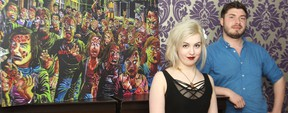 Holly Halftone (left) and Nyco Rudolph are photographed with one of Rudolph's work, Albert Zombies, in Winnipeg, Man., on Wed., May 14, 2014. Halftone has organized the Wildminds B-Movie Film Festival which runs at the Park Theatre on Saturday, while Rudolph is among the artists displaying work in the lobby, which will be transformed into Art Land. Kevin King/Winnipeg Sun/QMI Agency