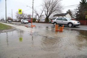 Gino Donato/The Sudbury Star A ditch at First and Second avenues in Minnow Lake overflowed onto the sidewalk and in this 2014 file photo.