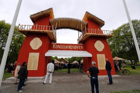 """Guests attend the opening of the """"Congo Village"""" in Oslo May 15, 2014. Displaying 80 people in a human zoo in Oslo's most elegant park, two artists hope their """"Congo Village"""" display will help erase what they say is Norwegians' collective amnesia about racism. (REUTERS/Lise Aserud/NTB Scanpix)"""