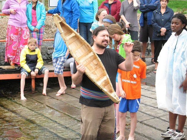 Christian Pilon, a Metis, originally from the Sudbury area, with the student-built miniature canoe, on  Fri., May 16, 2014, at  the Ecole Marie-Tanguay canoe launch in Lamoureux Park in Cornwall.TODD HAMBLETON/CORNWALL STANDARD-FREEHOLDER/QMI AGENCY