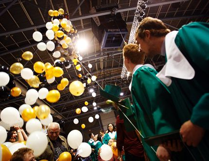 Balloons drop over the class of 2014 at the Cap and Gown ceremony on Friday afternoon at the Crystal Centre on 99 Avenue in Grande Prairie, Alberta. The ceremony is part of graduation celebrations this week for St. Joseph's Catholic High School this weekend. TOM BATEMAN/DAILY HERALD-TRIBUNE/QMI AGENCY