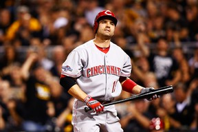 Joey Votto has a strained left quadriceps. (Jared Wickerham/Getty Images/AFP)