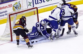 Marlies goalie Drew MacIntyre gets the knob of his stick on this close-in chance by Wolves' Jani Hakanpaa last night at the Ricoh Coliseum, one of 30 saves he made in a series-clinching 4-0 win. (Dave Thomas, Toronto Sun)