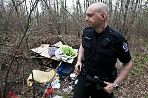 Const. Craig Beaton of the EPS Community Action Team (CAT) shows media a homeless camp found in Mill Creek Ravine on Friday. (David Bloom/Edmonton Sun)